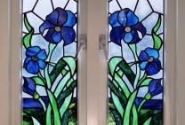 glas in lood irissen motief