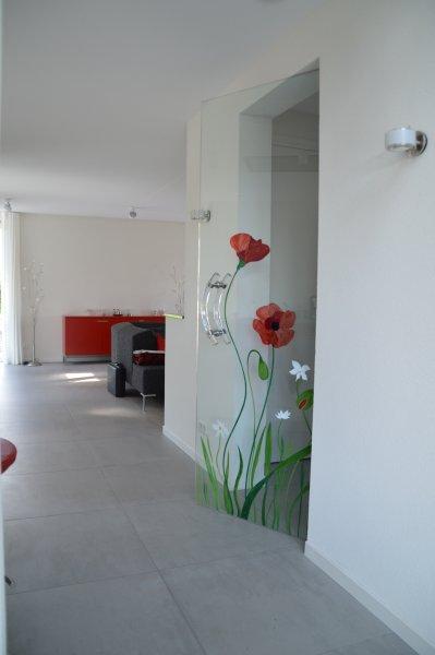 https://www.edelglas.nl/wp-content/gallery/glazen-deuren_1/glazen-deur-klaprozen-edelglas.jpg?x41857